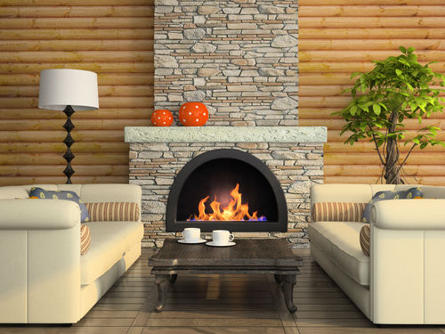 stone fireplace surrounded by beige couches