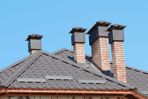 chimney caps on a tile roof