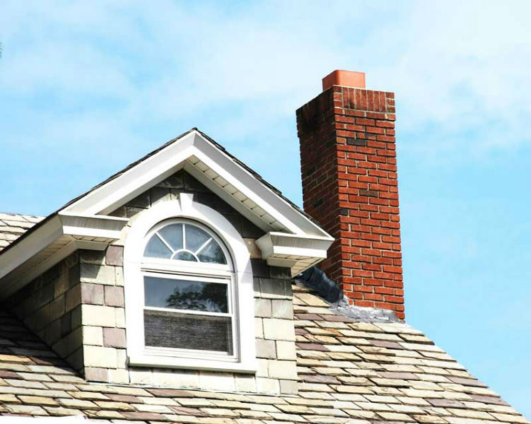 shingled roof with red brick chimney