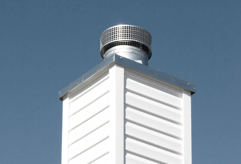 chimney cover on a white chimney